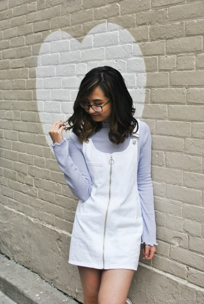 lavender sweater with white overall mini dress