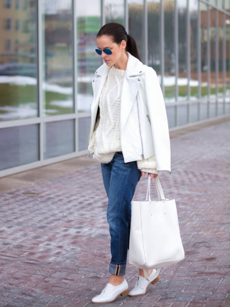 leather jacket with cable knit sweater and white shoes