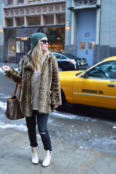leopard print fleece jacket with jeans and white snow boots