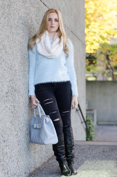 light blue teddy sweater with black ripped skinny jeans