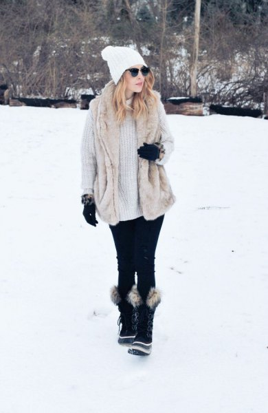 light grey ribbed chunky sweater dress with black faux fur snow boots