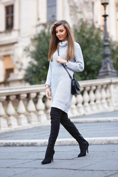 light grey turtleneck knit sweater dress with black heeled thigh high boots
