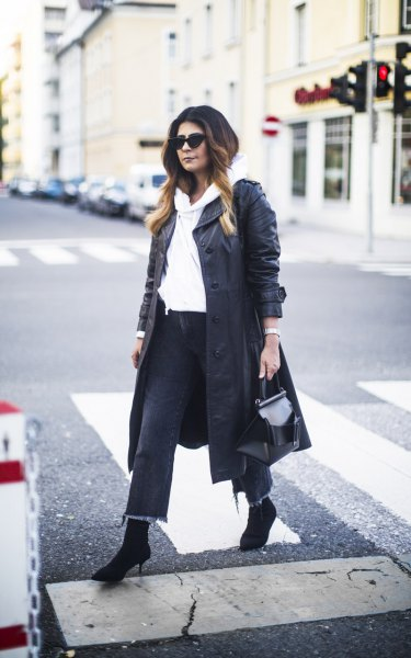 long leather coat with white hoodie and cropped jeans