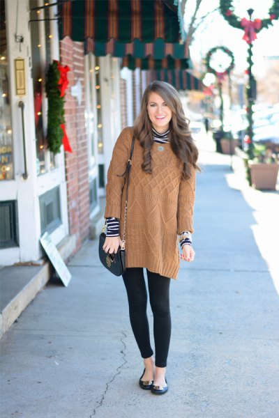 long light brown cable knit sweater with black and white striped top