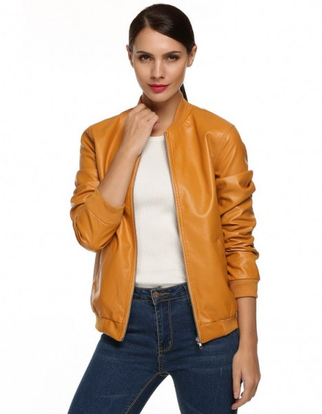 mustard leather bomber jacket with dark blue jeans