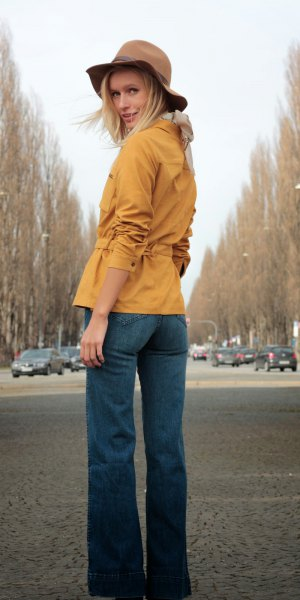 mustard yellow belted suede shirt with blue flared jeans