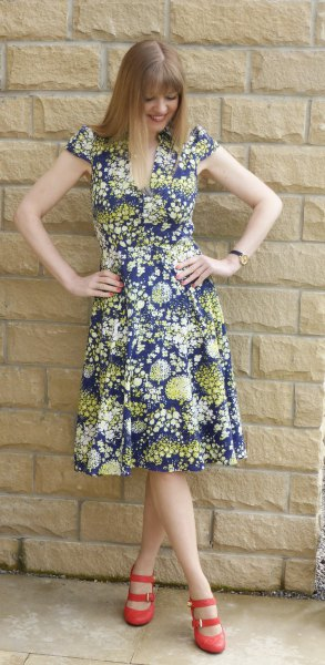 navy and orange floral printed breezy midi dress