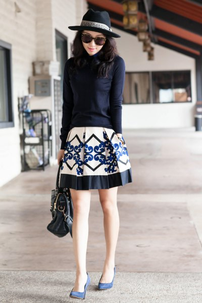 navy fitted knit sweater with white and black printed skater skirt