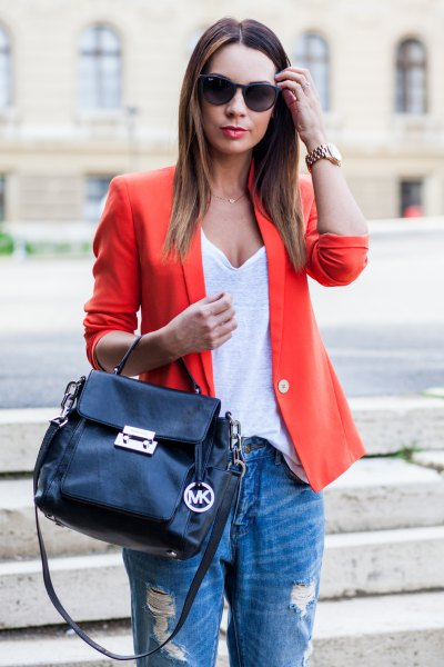 orange blazer with white deep v neck vest top and boyfriend jeans