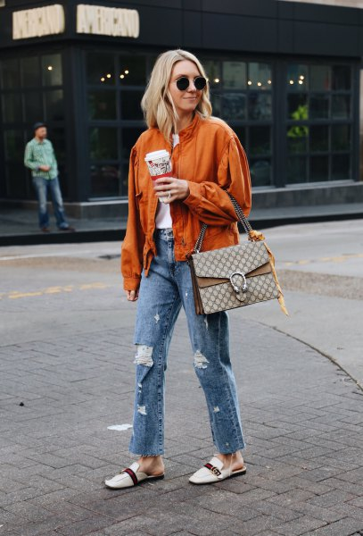 orange bomber jacket with boyfriend jeans