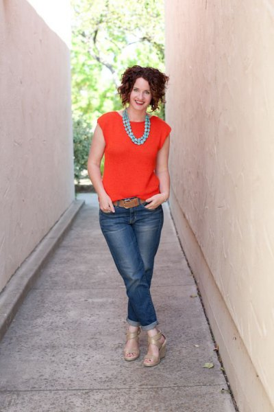 orange cap sleeve blouse with cuffed jeans and brown belt