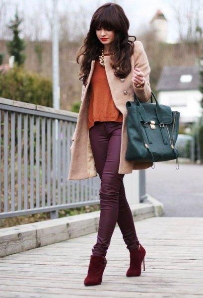 pale pink wool coat with purple skinny jeans