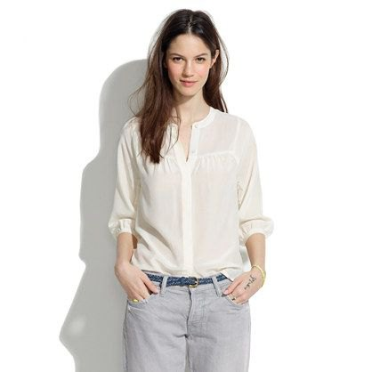 pale yellow no collar shirt with light grey jeans