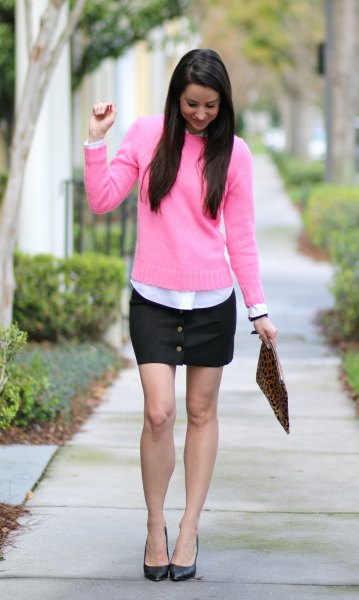 pink sweater with white button up shirt and black mini skirt