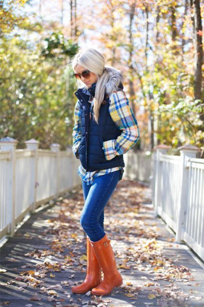 plaid shirt with puffer vest and orange leather knee high boots
