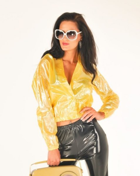 plastic yellow bomber jacket with matching black pants