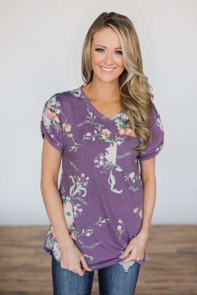 purple and white floral tee with blue jeans