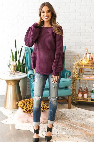 purple boat neck ribbed sweater with ripped jeans