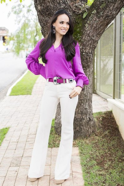 purple button up blouse with white flared jeans