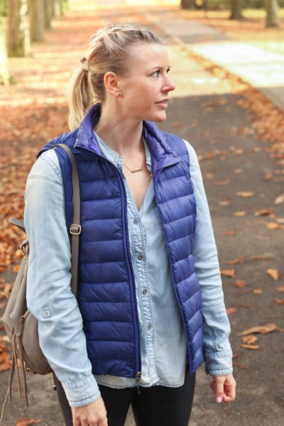 purple down vest with light blue chambray button up shirt