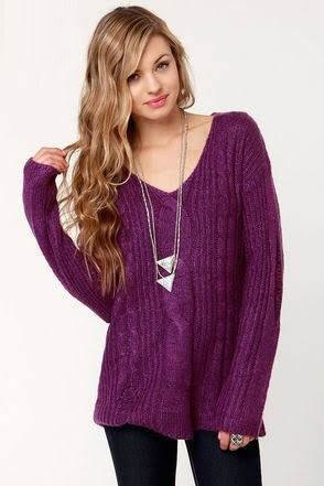 purple v neck cable knit sweater with black skinny jeans