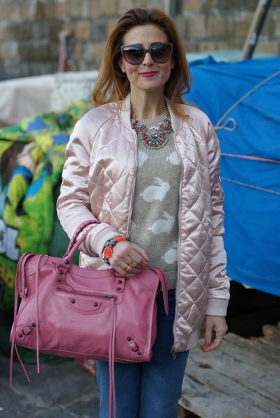 quilted white bomber jacket with blush pink printed sweater