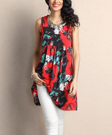 red and black floral printed tunic top with white skinny jeans