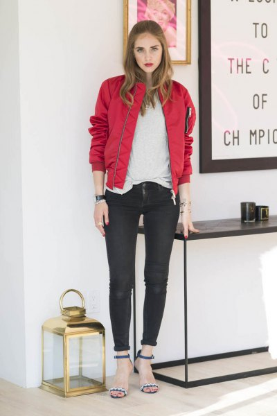 red bomber jacket with white tee and black cuffed skinny jeans