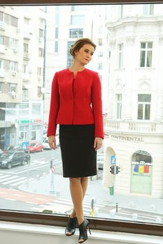 red fitted jacket with black knee length skirt