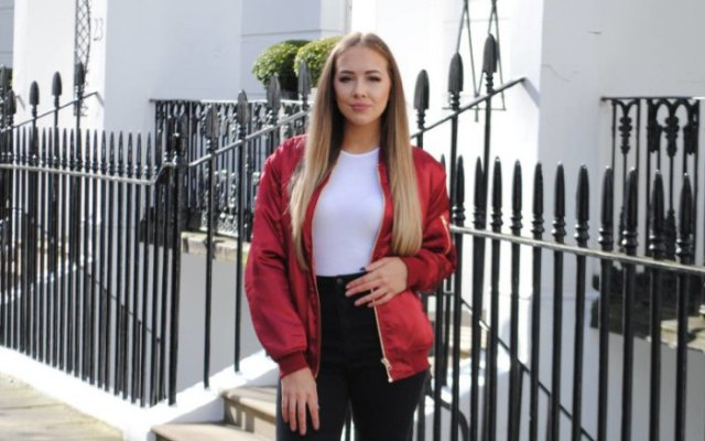 red jacket with white form fitting top and black high waisted jeans