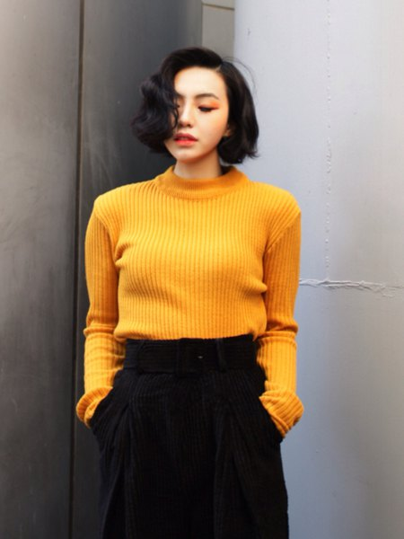 ribbed yellow sweater with black wide leg cropped pants