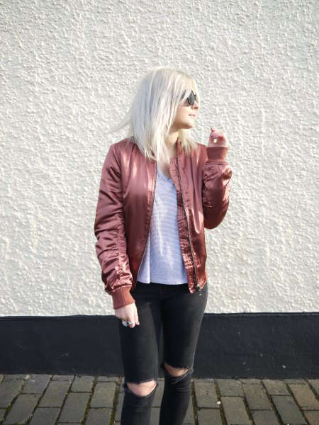 rose gold bomber jacket with striped tee and black ripped jeans