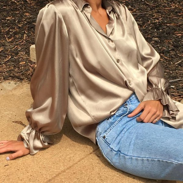 rose gold silk button up shirt with light blue skinny jeans