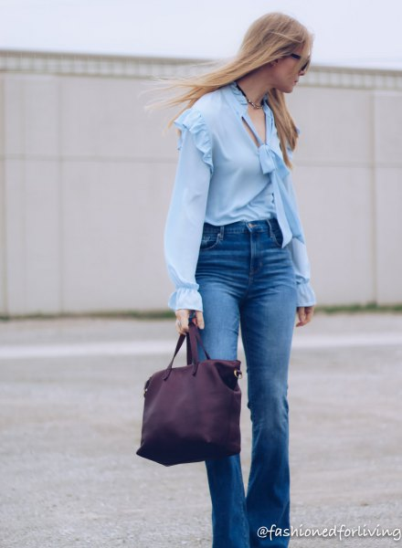 ruffle shoulder puff sleeve light blue blouse with flared jeans