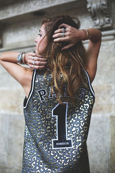 silver and pink basketball jersey tank top with blue denim shorts