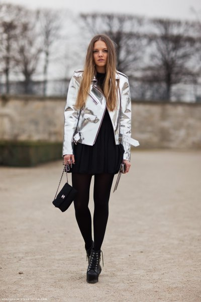 silver metallic jacket with black shift mini dress