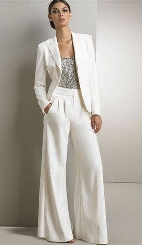 silver top with white blazer and matching flared pants