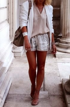 white blazer with blush pink blouse and shiny shorts