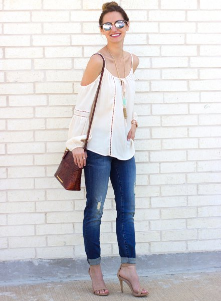 white boho style cold shoulder blouse with cuffed blue jeans