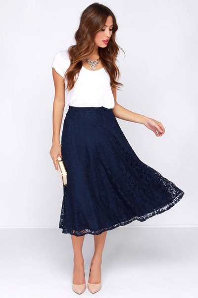 white cap sleeve t shirt with navy midi flared skirt