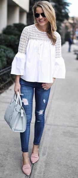 white crochet lace blouse with blue ripped skinny jeans