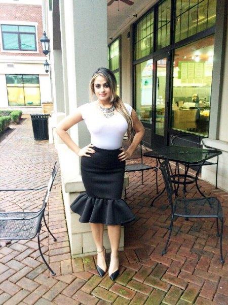 white form fitting cap sleeve top with black knee length mermaid skirt