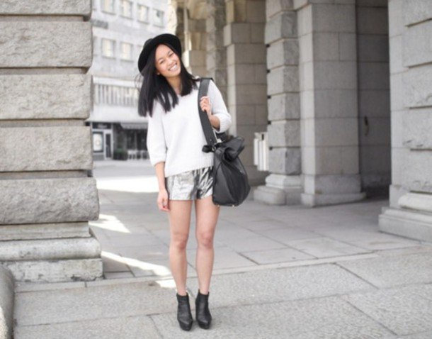 white half sleeve knit sweater with silver shorts and felt hat