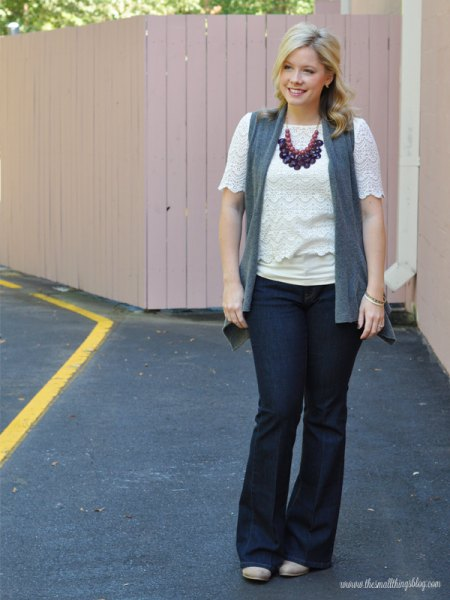 white lace top with vest and blue flared jeans
