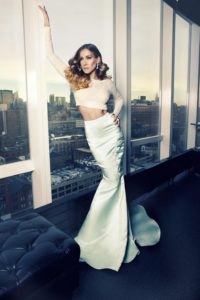 white long sleeve form fitting crop top with silver maxi mermaid skirt