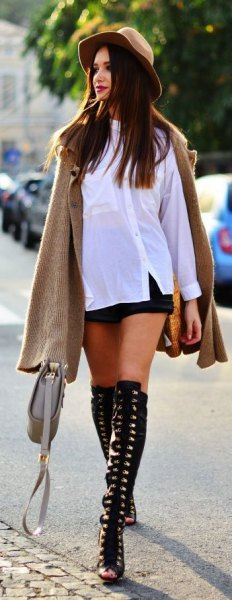 white long sleeve tee and mini black shorts