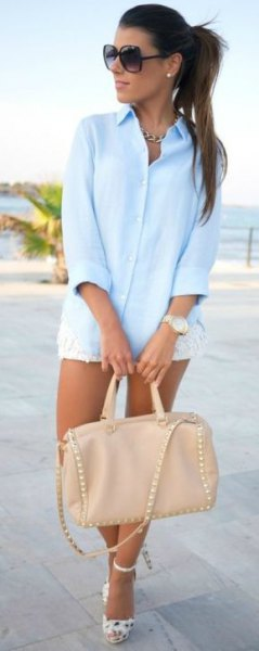 white mini lace shorts and pink leather purse