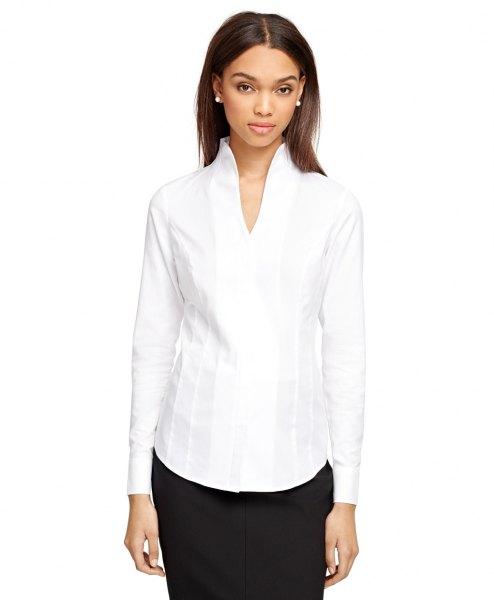 white mock neck collar less mini v neck shirt with black skirt