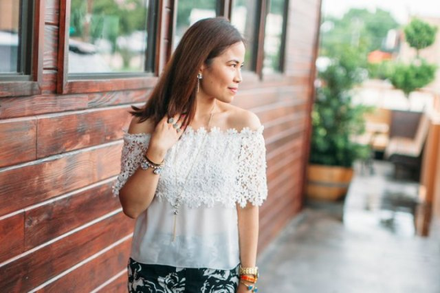 white off the shoulder semi sheer lace and chiffon top with black floral printed skirt