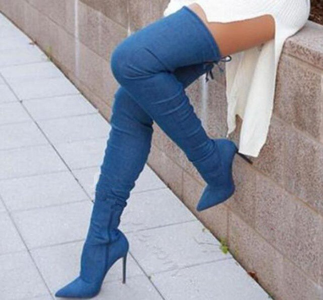 white ribbed sweater dress with heeled denim thigh high boots
